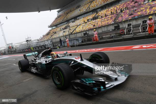 Mercedes' British driver Lewis Hamilton comes into the pits during a practice session ahead of the Formula One Chinese Grand Prix in Shanghai on...