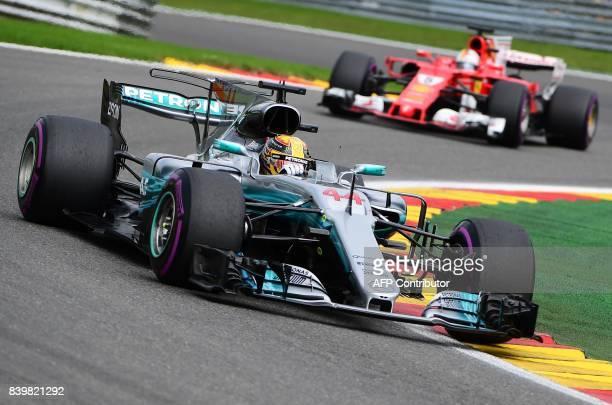 TOPSHOT Mercedes' British driver Lewis Hamilton competes to win ahead of Ferrari's German driver Sebastian Vettel during the Belgian Formula One...