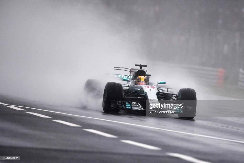 TOPSHOT - Mercedes' British driver Lewis Hamilton competes to win the pole position during the qualifying session at the Autodromo Nazionale circuit in Monza on September 2, 2017 ahead of the Italian Formula One Grand Prix. /