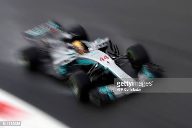 TOPSHOT Mercedes' British driver Lewis Hamilton competes to win the pole position during the qualifying session at the Autodromo Nazionale circuit in...