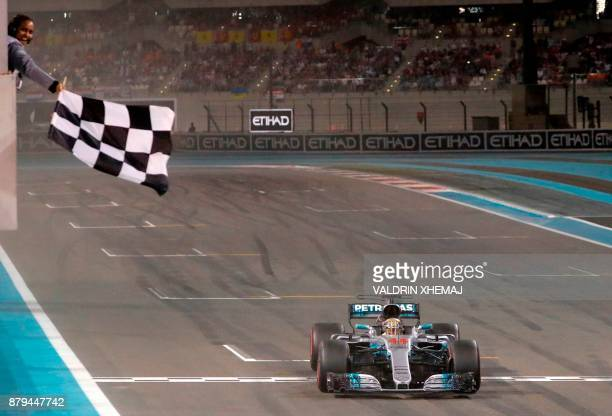TOPSHOT Mercedes' British driver Lewis Hamilton crosses the finish line during the Abu Dhabi Formula One Grand Prix at the Yas Marina circuit on...