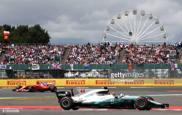 TOPSHOT Mercedes' British driver Lewis Hamilton drives ahead of Ferrari's Finnish driver Kimi Raikkonen during the British Formula One Grand Prix at...
