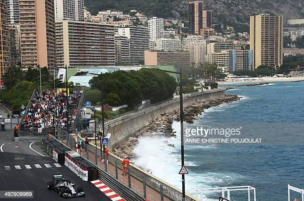Mercedes' British driver Lewis Hamilton drives at the Monaco street circuit during the second practice session of the Monaco Formula One Grand Prix...