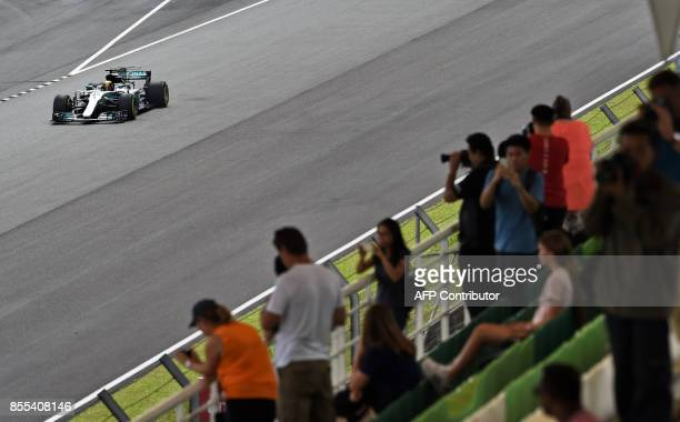 Mercedes' British driver Lewis Hamilton drives during his second practice session of the Formula One Malaysia Grand Prix at the Sepang circuit near...