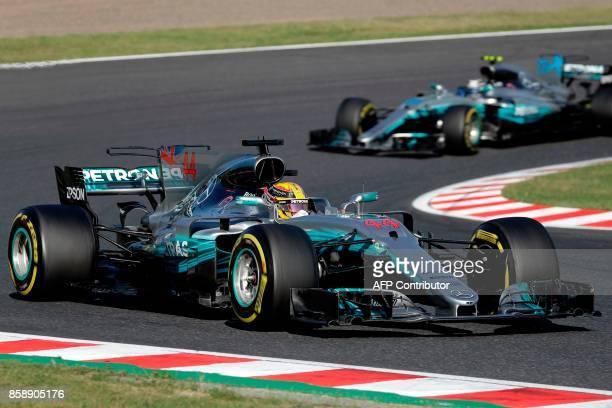 Mercedes' British driver Lewis Hamilton drives during the Formula One Japanese Grand Prix at Suzuka on October 8 2017 / AFP PHOTO / Kiyoshi OTA