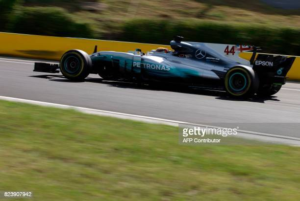 TOPSHOT Mercedes' British driver Lewis Hamilton drives during the free practice session at the ahead of the Formula One Hungarian Grand Prix at the...