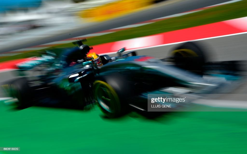 TOPSHOT - Mercedes' British driver Lewis Hamilton drives during the qualifying session at the Circuit de Catalunya on May 13, 2017 in Montmelo on the outskirts of Barcelona ahead of the Spanish Formula One Grand Prix. /