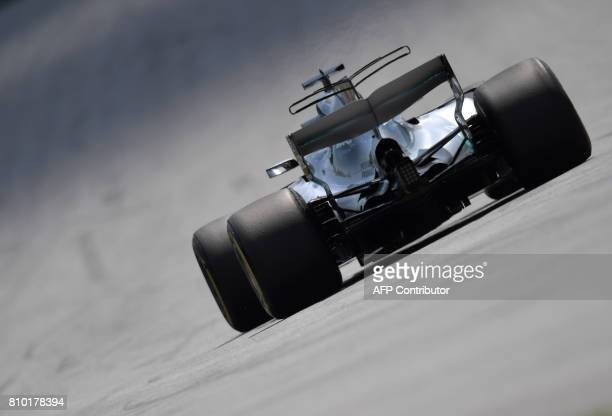 TOPSHOT Mercedes' British driver Lewis Hamilton drives his car during the first practice session of the Formula One Austria Grand Prix at the Red...