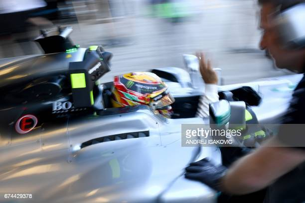 TOPSHOT Mercedes' British driver Lewis Hamilton gestures from his car during the second practice session of the Formula One Russian Grand Prix at the...