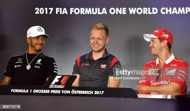 Mercedes' British driver Lewis Hamilton Haas F1's Danish driver Kevin Magnussen and Ferrari's German driver Sebastian Vettel attend a driver's press...