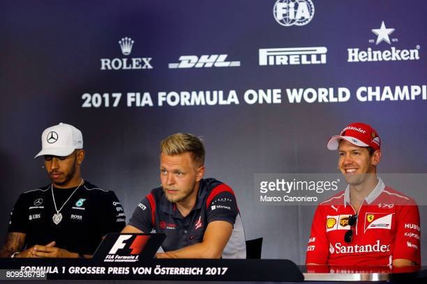 Mercedes' British driver Lewis Hamilton Haas F1's Danish driver Kevin Magnussen and Ferrari's German driver Sebastian Vettel during driver's press...