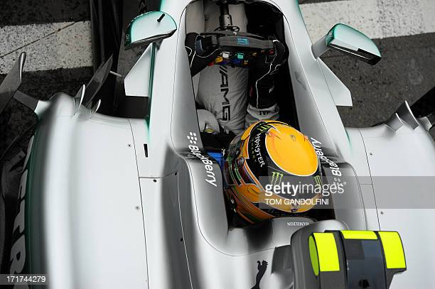 Mercedes' British driver Lewis Hamilton leaves the pits during the second practice session at the Silverstone circuit in Silverstone on June 28 2013...