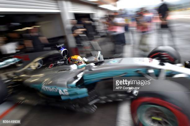 TOPSHOT Mercedes' British driver Lewis Hamilton leaves the pits during the third practice session at the SpaFrancorchamps circuit in Spa on August 26...