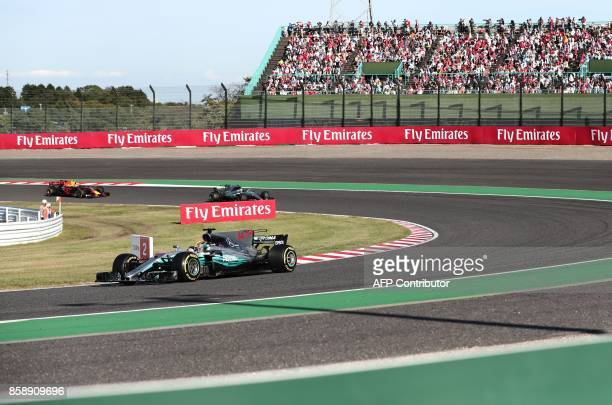 Mercedes' British driver Lewis Hamilton Mercedes' Finnish driver Valtteri Bottas and Red Bull's Dutch driver Max Verstappen drive during the Formula...