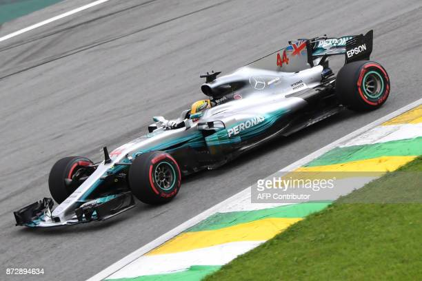 Mercedes' British driver Lewis Hamilton powers his car during the Brazilian Formula One Grand Prix Q1 qualifying session at the Interlagos circuit in...