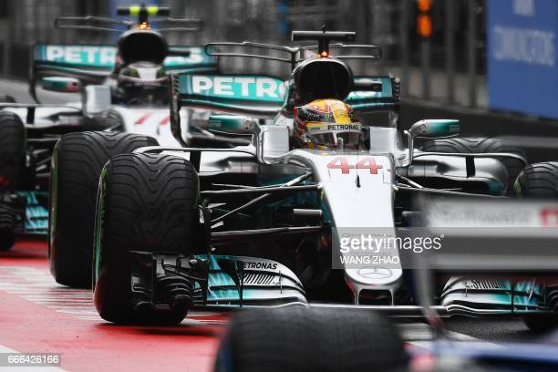 Mercedes' British driver Lewis Hamilton prepares to drive out of pits during the Formula One Chinese Grand Prix in Shanghai on April 9 2017 / AFP...