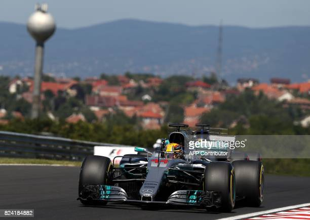 Mercedes' British driver Lewis Hamilton races during a free practice session at the Hungaroring racing circuit in Budapest on July 29 2017 prior to...