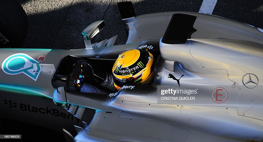 Mercedes' British driver Lewis Hamilton sits in his Formula One during the second day of testing at Jerez racetrack, on February 6, 2013 in Jerez de la Frontera.
