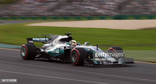 TOPSHOT Mercedes' British driver Lewis Hamilton speeds through a corner during the third practice session at the Formula One Australian Grand Prix in...
