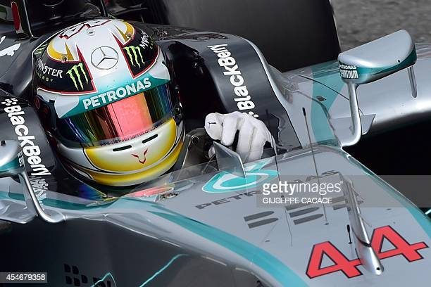 Mercedes' British driver Lewis Hamilton steers his car during the second practice session ahead of the Italian Formula One Grand Prix at the...