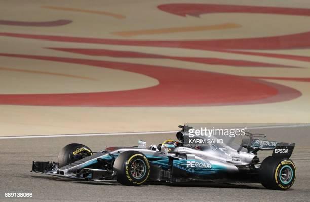 Mercedes' British driver Lewis Hamilton steers his car during the Bahrain Formula One Grand Prix at the Sakhir circuit in Manama on April 16 2017 /...