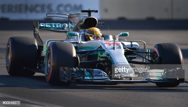 Mercedes' British driver Lewis Hamilton steers his car during the qualifying session for the Formula One Azerbaijan Grand Prix at the Baku City...