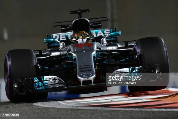 Mercedes' British driver Lewis Hamilton steers his car during the second practice session as part of the Abu Dhabi Formula One Grand Prix at the Yas...