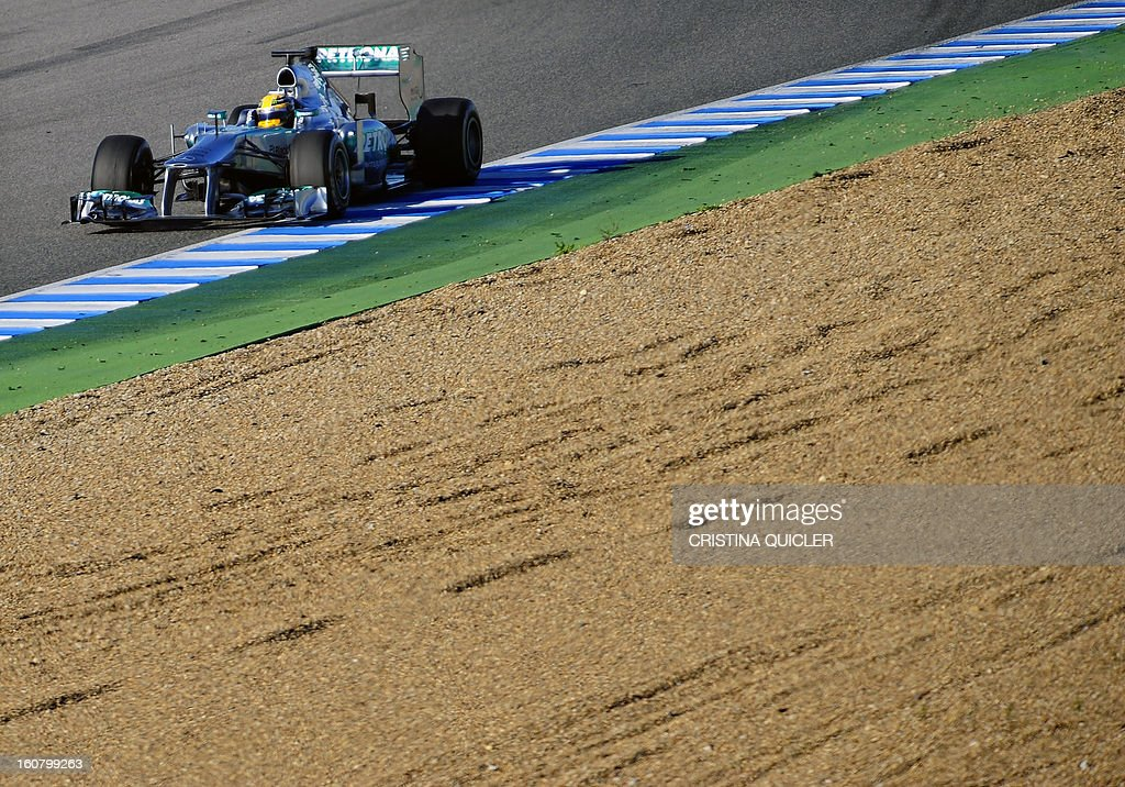 Mercedes' British driver Lewis Hamilton steers his Formula One during the second day of testing at Jerez racetrack, on February 6, 2013 in Jerez de la Frontera.
