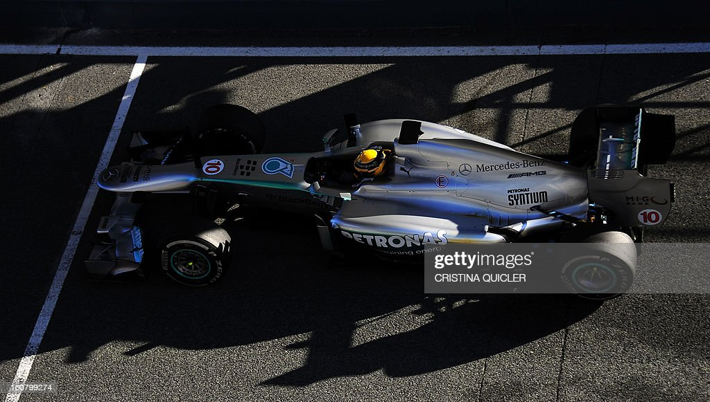 Mercedes' British driver Lewis Hamilton steers his Formula One during the second day of testing at Jerez racetrack, on February 6, 2013 in Jerez de la Frontera. AFP PHOTO/ CRISTINA QUICLER