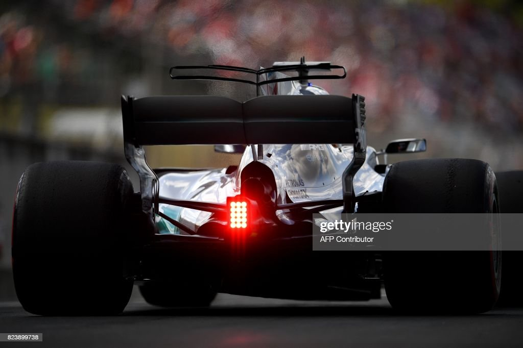 TOPSHOT - Mercedes' British driver Lewis Hamilton takes part in a practice session at the Hungaroring racing circuit in Budapest on July 28, 2017 prior to the Formula One Hungarian Grand Prix. /