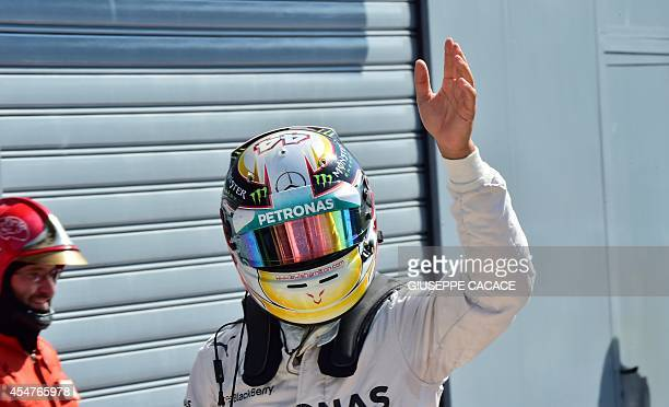 Mercedes' British driver Lewis Hamilton waves after qualifying for the pole position at the Autodromo Nazionale circuit in Monza on September 6 ahead...