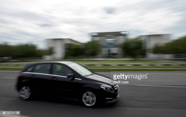 Mercedes car passes the chancellery on July 24 2017 in Berlin Germany Germany's biggest car companies VW Audi Porsche BMW and Daimler are being...