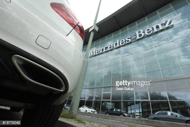 Mercedes car with its exhaust pipe in view stand outside a MercedesBenz dealership on July 13 2017 in Berlin Germany German media Sueddeutsche...