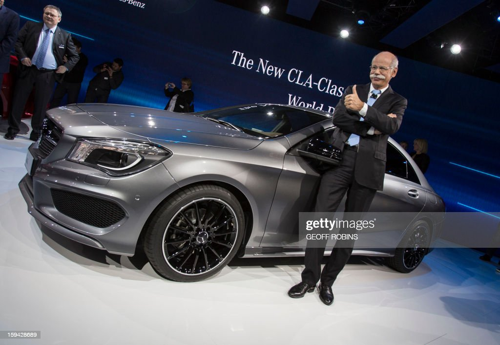 Mercedes Chairman of the Board Dr. Dieter Zetsche poses for a photo at the launch of the company's CLA class car on the eve of the 2013 North American International Auto Show in Detroit, Michigan, January 13, 2013. AFP PHOTO / Geoff ROBINS