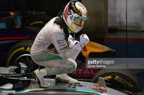 Mercedes driver Lewis Hamilton of Britain celebrates after winning the Formula One Singapore Grand Prix at the Marina Bay street circuit on September...