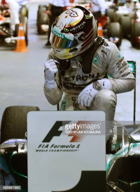 Mercedes driver Lewis Hamilton of Britain celebrates his victory after the Singapore Formula One Grand Prix in Singapore on September 21 2014 AFP...