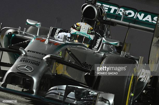 Mercedes driver Lewis Hamilton of Britain drives during the Formula One Singapore Grand Prix at the Marina Bay Street circuit on September 21 2014...