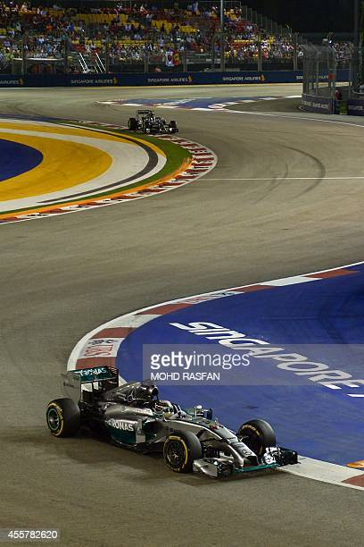 Mercedes driver Lewis Hamilton of Britain drives during the qualifying session of the Formula One Singapore Grand Prix at the Marina Bay Street...
