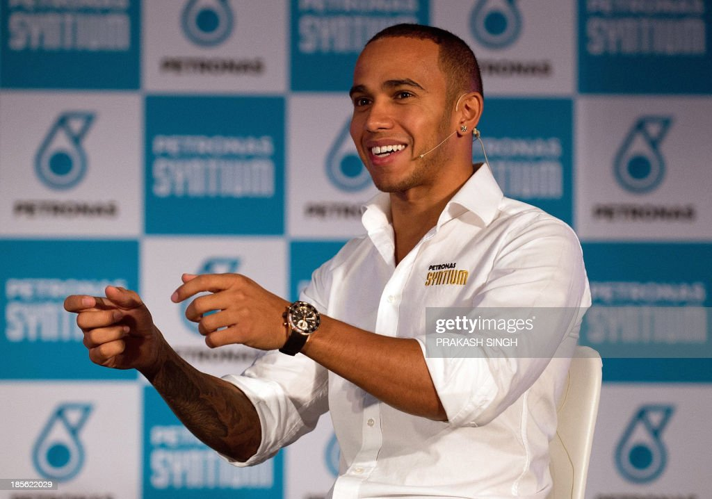 Mercedes driver Lewis Hamilton of Britain gestures during a media event ahead of the Indian Grand Prix in New Delhi on October 23, 2013. The 2013 Indian Formula One Grand Prix takes place in Greater Noida on the outskirts of New Delhi on October 27. AFP PHOTO/ Prakash SINGH