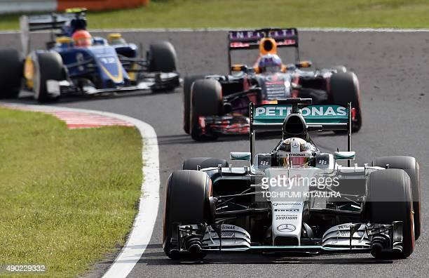 Mercedes driver Lewis Hamilton of Britain leads Red Bull driver Daniel Ricciardo of Australia and Sauber driver Felipe Nasr of Brazil during the...