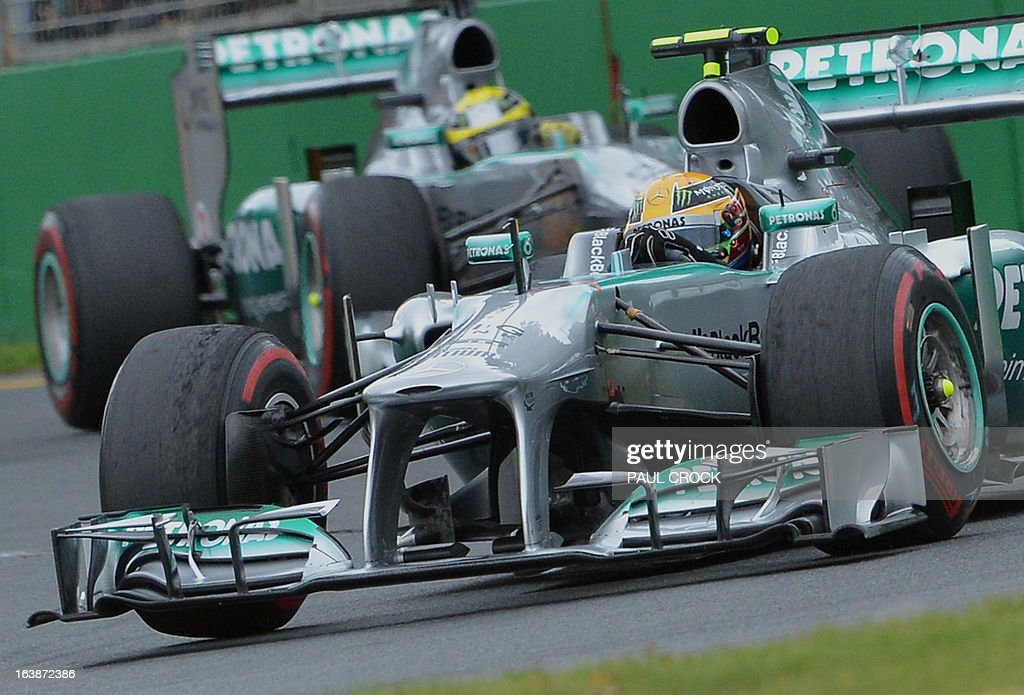 Mercedes driver Lewis Hamilton (R) of Britain leads team-mate Nico Rosberg (L) of Germany through a corner during the Formula One Australian Grand Prix in Melbourne on March 17, 2013. IMAGE RESTRICTED TO EDITORIAL USE - STRICTLY NO COMMERCIAL USE AFP PHOTO / Paul CROCK