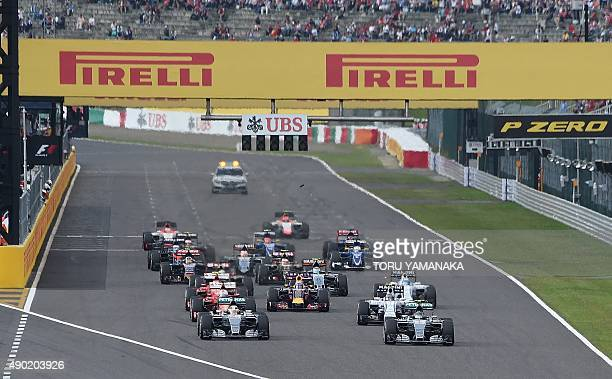Mercedes driver Lewis Hamilton of Britain leads the pack at the start of the Formula One Japanese Grand Prix in Suzuka on September 27 2015 AFP...