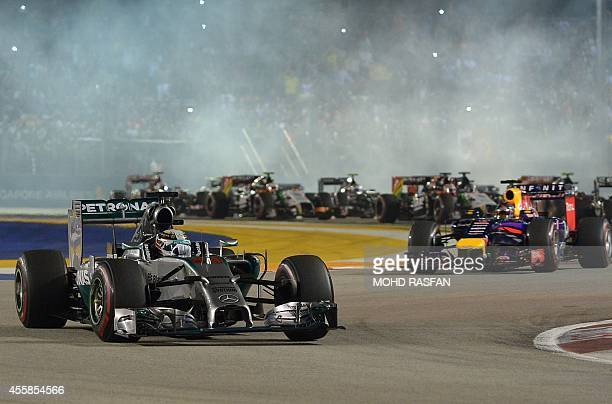 Mercedes driver Lewis Hamilton of Britain leads the pack during the Formula One Singapore Grand Prix at the Marina Bay street circuit on September 21...