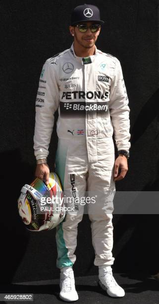 Mercedes driver Lewis Hamilton of Britain poses for the season opening portrait ahead of the Formula One Australian Grand Prix in Melbourne on March...