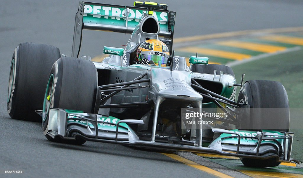 Mercedes driver Lewis Hamilton of Britain powers through a corner during the Formula One Australian Grand Prix in Melbourne on March 17, 2013. IMAGE RESTRICTED TO EDITORIAL USE - STRICTLY NO COMMERCIAL USE AFP PHOTO / Paul CROCK