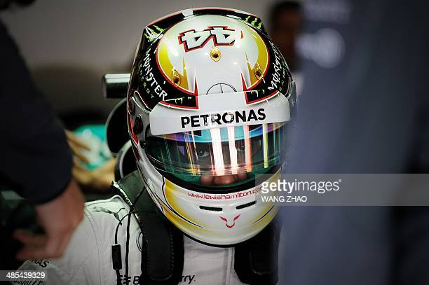 Mercedes driver Lewis Hamilton of Britain prepares to drive in the pits during the Formula One Chinese Grand Prix in Shanghai on April 18 2014 AFP...