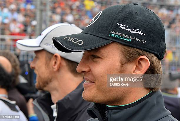 Mercedes driver Niko Rosberg of Germany walks during the drivers parade prior to the start of the Formula One Australian Grand Prix in Melbourne on...