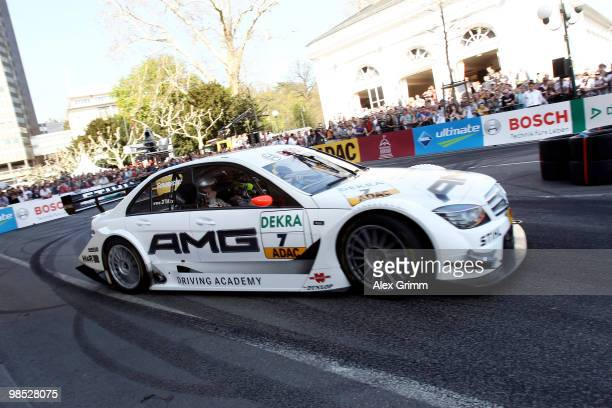 Mercedes driver Ralf Schumacher of Germany steers his car during the presentation of the German Touring Car Championship DTM in front of the Kurhaus...