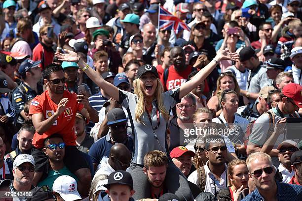 A Mercedes fan cheers on Mercedes AMG Petronas F1 Team's British driver Lewis Hamilton after he won the British Formula One Grand Prix at the...
