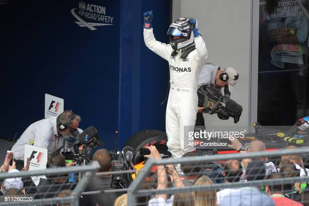 Mercedes' Finnish driver Valtteri Bottas celebrates after winning the Formula One Austria Grand Prix at the Red Bull Ring in Spielberg on July 9 2017...